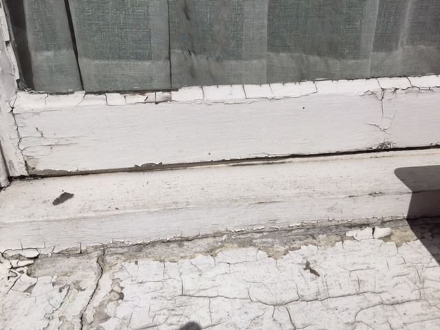 Poor condition of the timber sash window