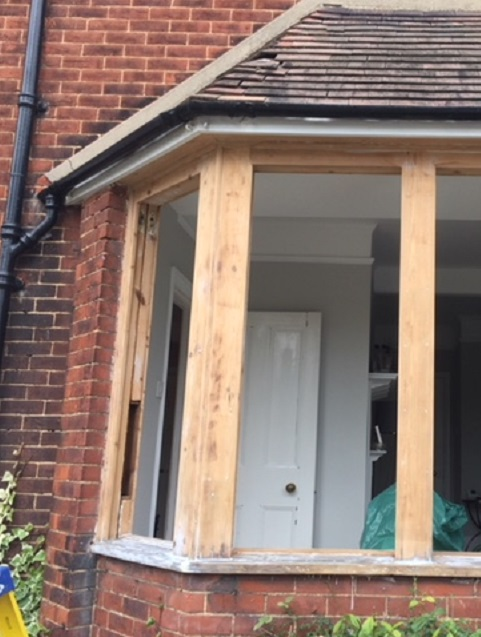 Timber bay window being renovated and having draught proofing added