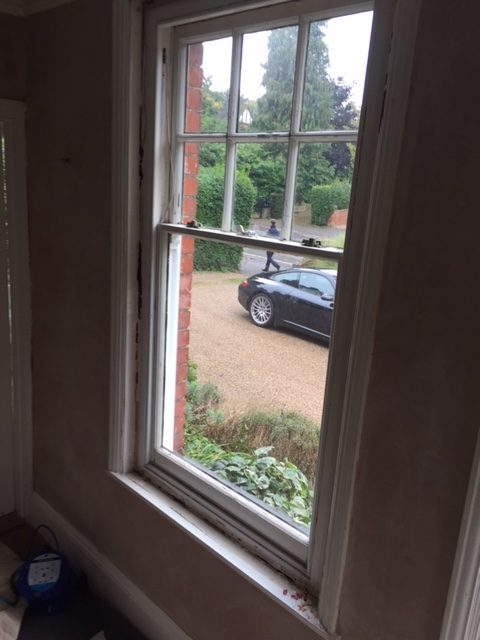 Tired timber in a the existing timber sash window frames