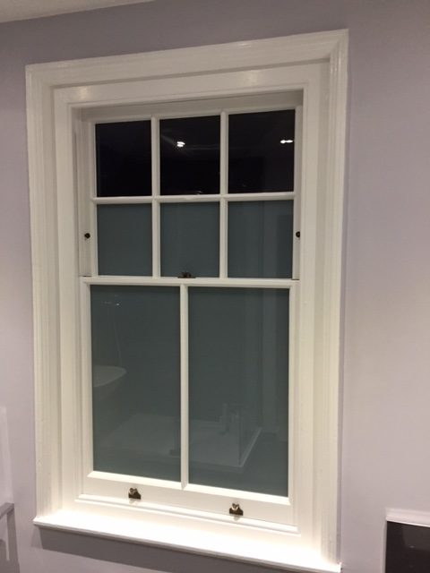 Repaired timber sash window looking and working like new