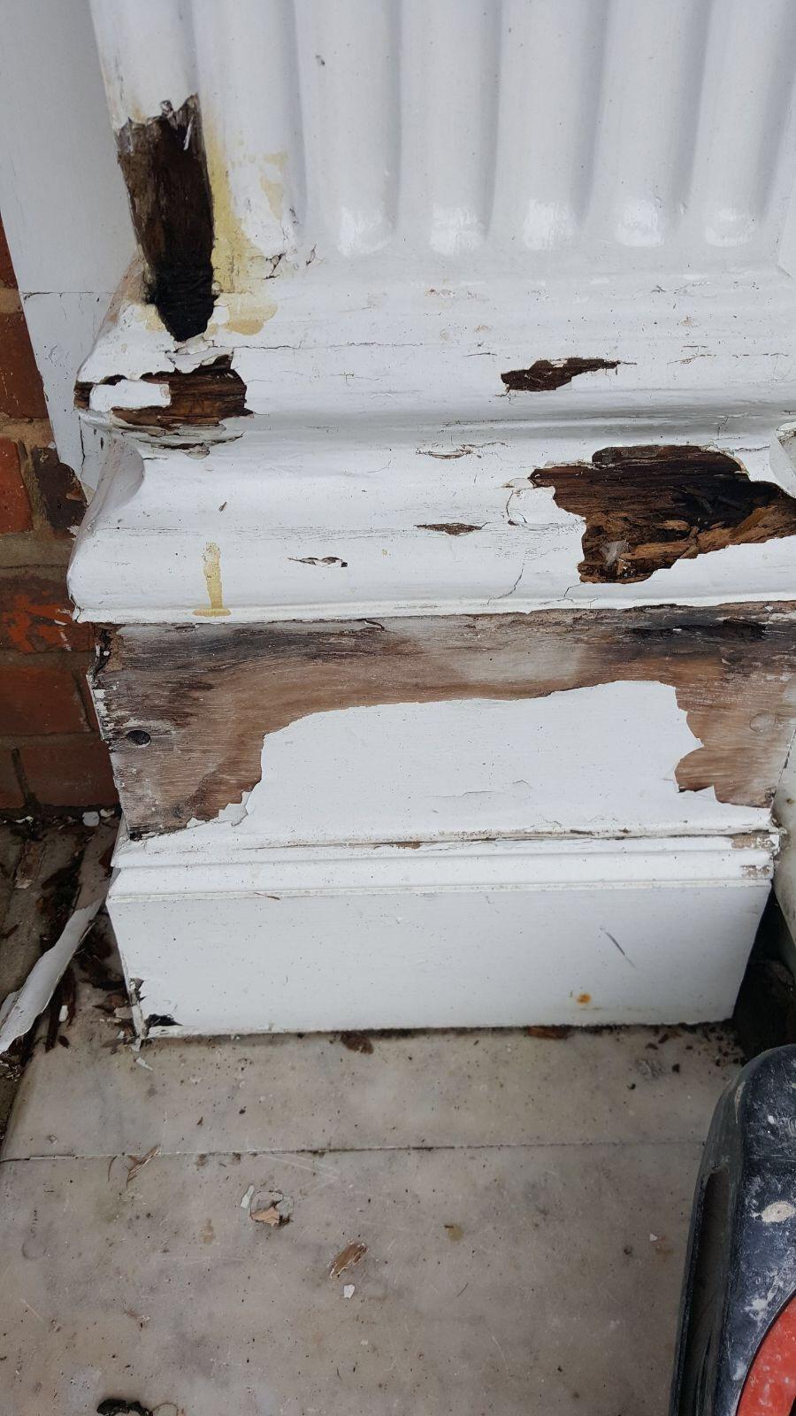 Rotten timber entrance column