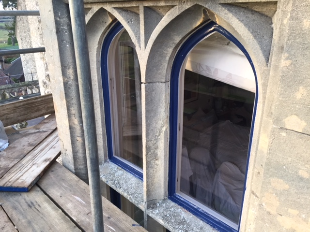 stone bay window with timber frames restored